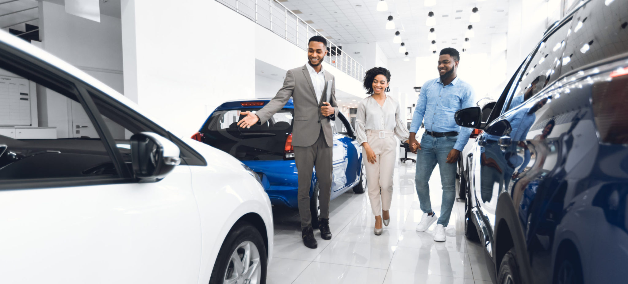 Car Selling Business Manager Showing Luxury Automobile To Man And Spouse